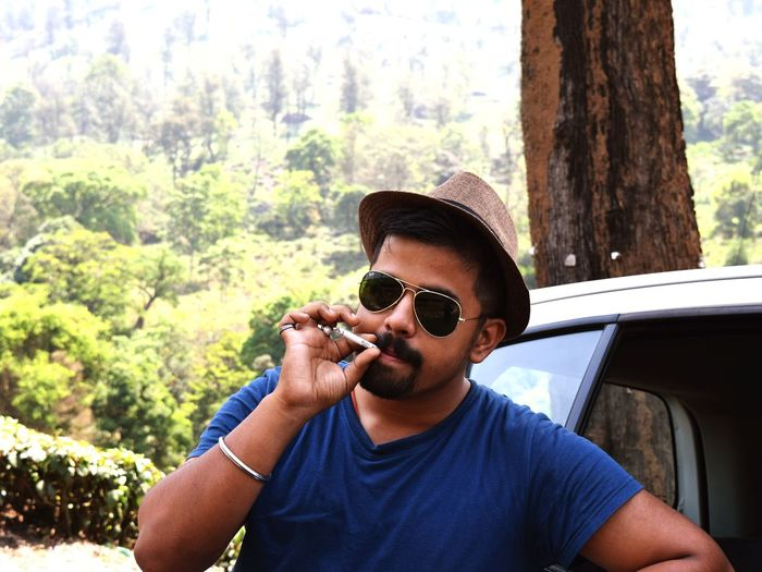 God's Own Country Tree Portrait Men Headshot Forest Beard Mid Adult Front View Sunglasses Close-up Smoking