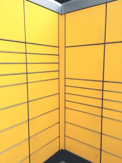 Metal grate on yellow wall