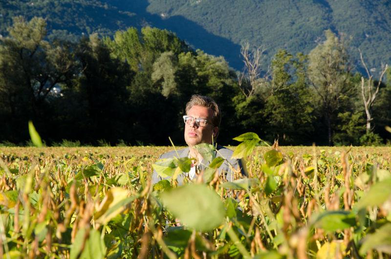 Mature Man Amidst Plants On Field