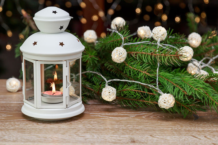 white lantern with a candle and a spruce branch for Christmas Christmas Around The World Christmas Spirit Decor Garland Lantern Light MAS New Year Tree Xmas Bokeh Branch Candle Candle Light Celebration Christmas Christmas Decoration Christmas Is Coming Christmas Tree Gift Indoors  Lamp No People Preparation  Tradition