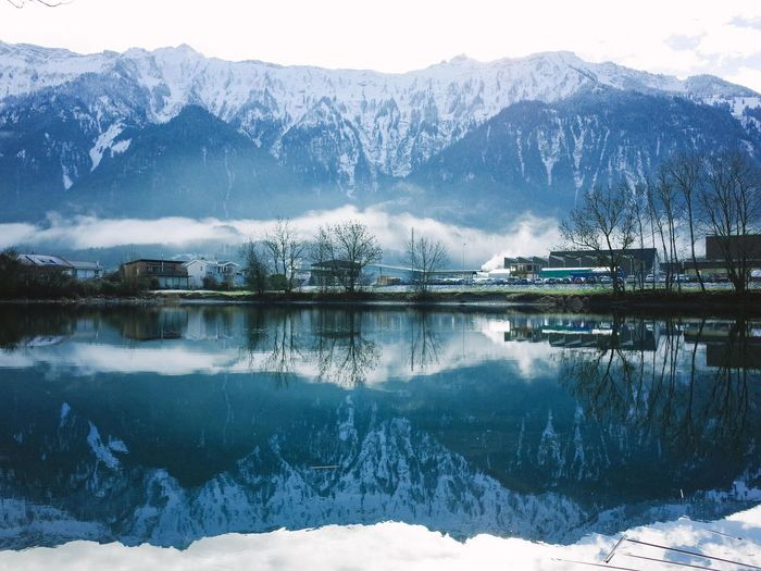 Beauty In Nature Cold Temperature Covering Frozen Lake Landscape Mountain Mountain Range Nature Non-urban Scene Reflection Scenics Season  Snow Snowcapped Mountain Tranquil Scene Tranquility Water Weather Winter