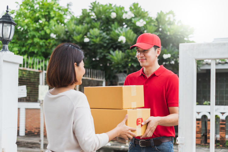 Young couple holding hands in box