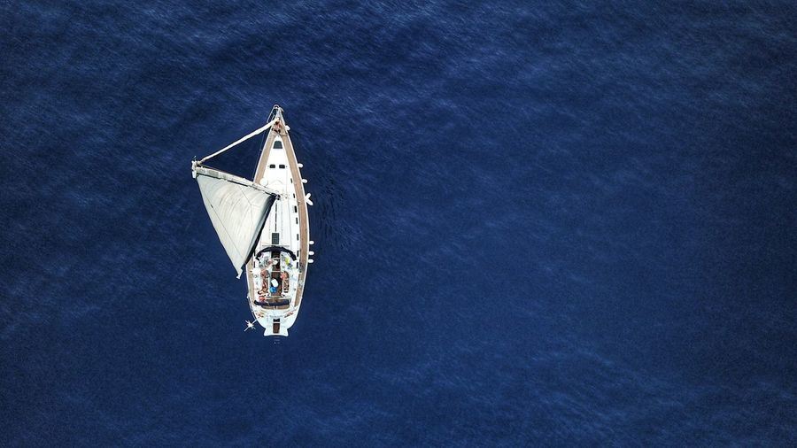 Drone view of ship sailing on sea