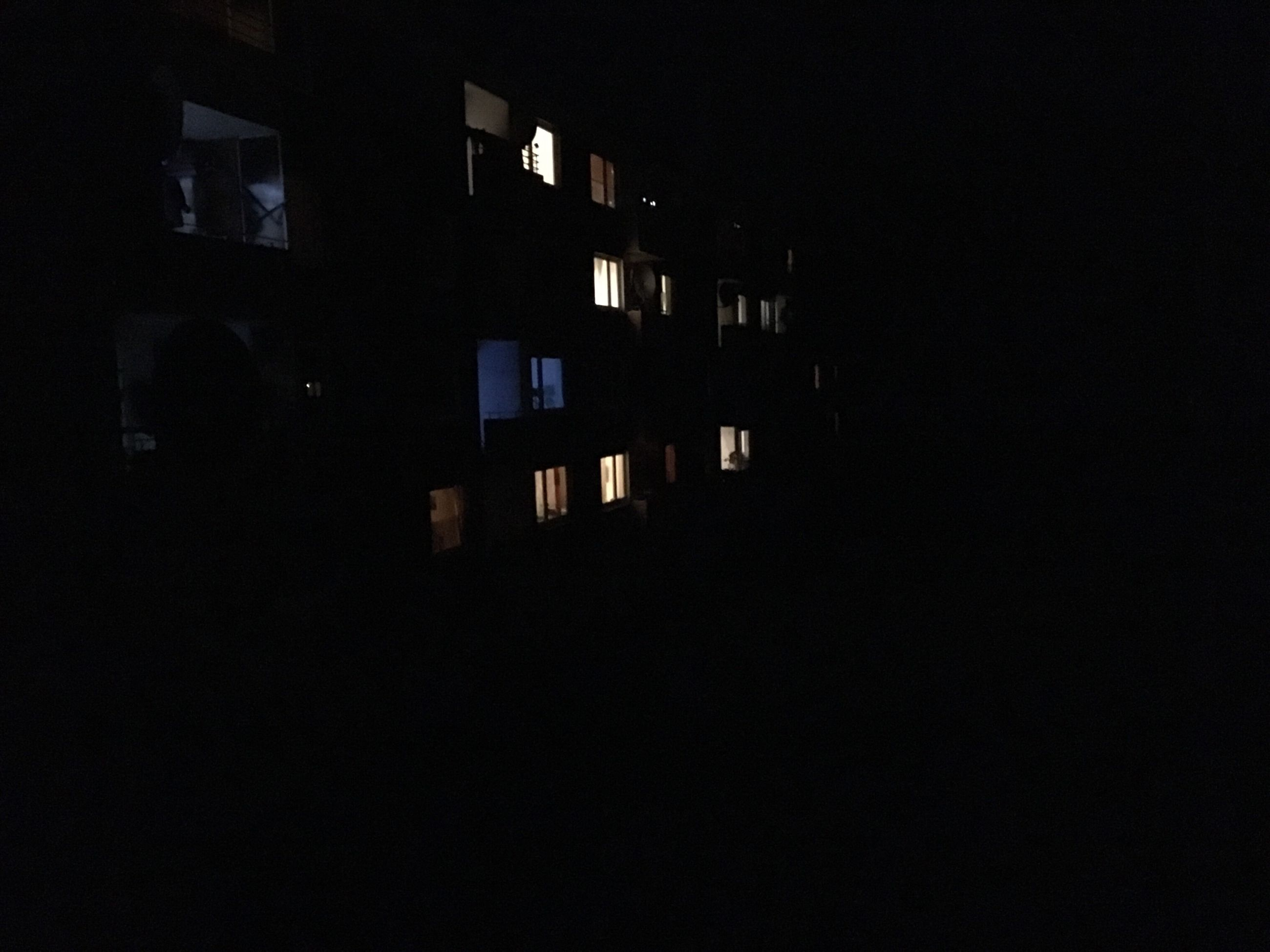 architecture, built structure, building exterior, night, dark, illuminated, window, residential structure, building, residential building, copy space, house, city, no people, outdoors, low angle view, clear sky, apartment, silhouette, shadow