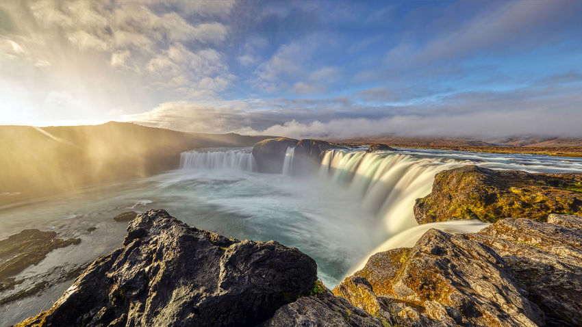 The Goðafoss is a waterfall in Iceland. It is located in the Bárðardalur district of Northeastern Region at the beginning of the Sprengisandur highland road. The water of the river Skjálfandafljót falls from a height of 12 meters over a width of 30 meters. Scenics - Nature Water Beauty In Nature Waterfall Motion Long Exposure Nature Flowing Water No People Outdoors Power In Nature Flowing Goðafoss Waterfall Sunrise Sunset Environment Blurred Motion Majestic Beauty In Nature Horseshoe Falls Rocks Sky Rock Rock - Object Solid Cloud - Sky Non-urban Scene Mountain Day