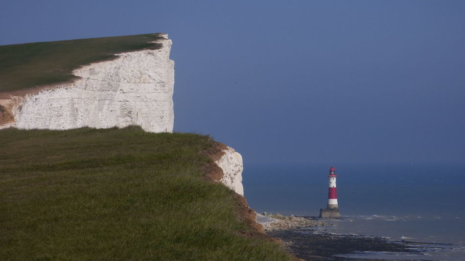 Beachy Head Lighthouse Architecture Beachy Head Beachy Head Lighthous Blackandwhite Blue Built Structure Day English Channel Lighthouse No People Outdoors Red And White Rock Formation Scenics Stripes Everywhere Water