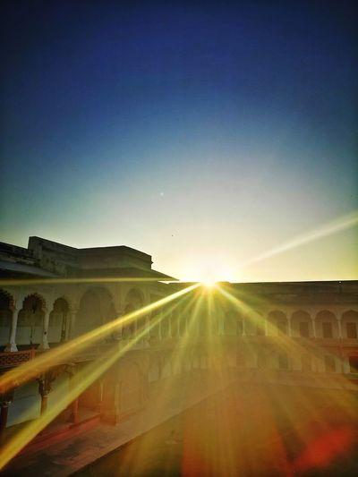 Agra Fort Golden Sunset Sunrays Sun Beams Historical Building Fort Old Fort Sunset Gpmzn Leica Photography. EyeEm Best Shots EyeEm Selects Dramatic Sunset Sunset Clear Sky Dawn Sunlight Multi Colored Sun Sunbeam