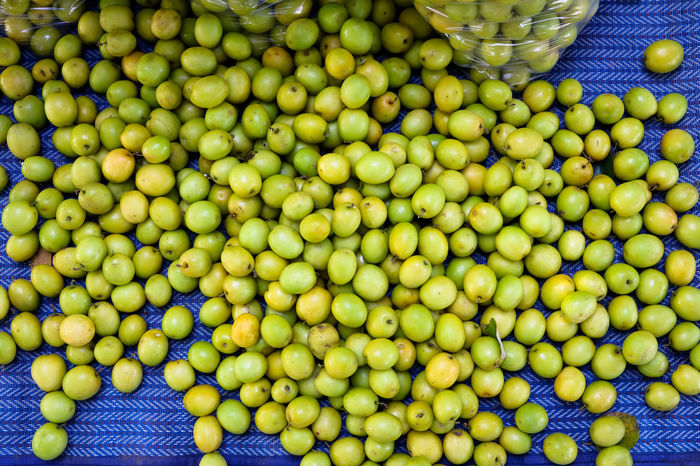 Day Food Food And Drink For Sale Freshness Fruit Full Frame Green Color Healthy Eating Large Group Of Objects Market Market Stall Monkey Apple No People Outdoors Retail  ลูกพุทรา