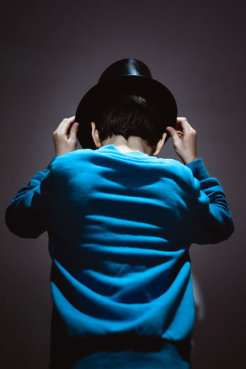Cool Dark Hat Isolated Blue Boys Childhood Human Back Indoors  Lifestyles One Person Real People Rear View Standing Studio Shot Inner Power Visual Creativity My Best Photo