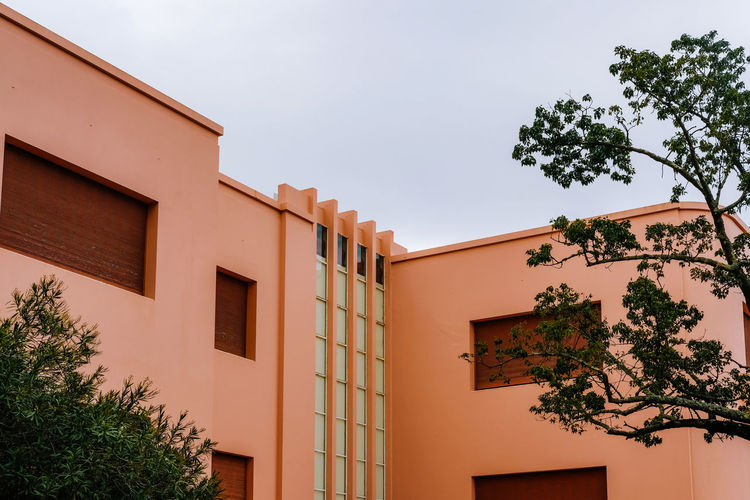 Architecture Tree Building Exterior Built Structure Plant Building Sky Window Nature Low Angle View Day No People Outdoors Growth House Residential District Orange Color Wall - Building Feature City Sunlight Apartment
