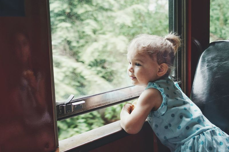 Child looking out train window