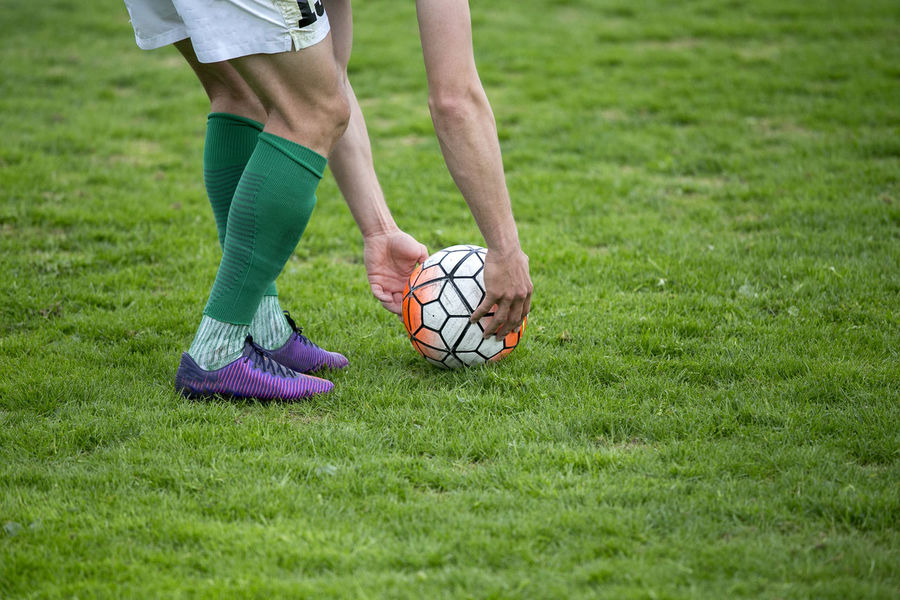 Adult Ball Day Field Grass Healthy Lifestyle Human Body Part Human Leg Lifestyles Low Section Men Nature One Person Outdoors People Playing Playing Field Soccer Soccer Ball Soccer Field Soccer Player Sport Sports Clothing Sportsman Standing