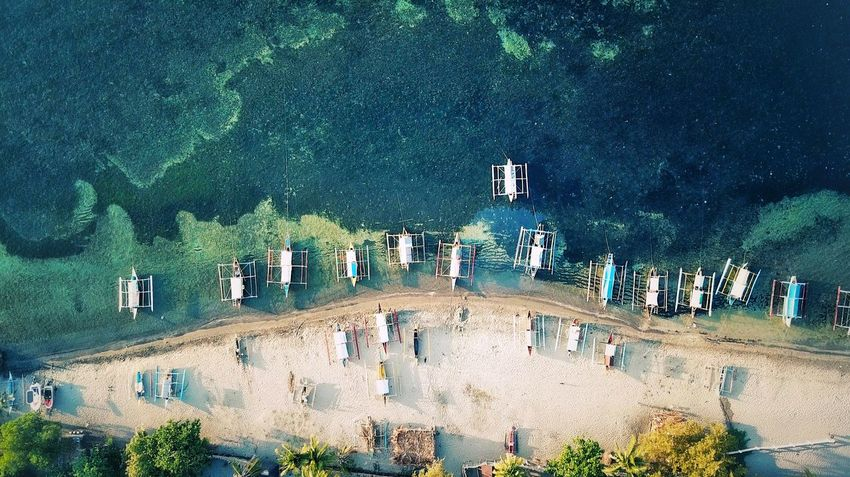 In row. Natural Nature Aerial View Aerial Dronephotography Fishing Boat Top View Ocean Seaside Morong Philippines Travel Destinations Boat Seascape Boat High Angle View Nature Water Day Outdoors Lifestyles Sea