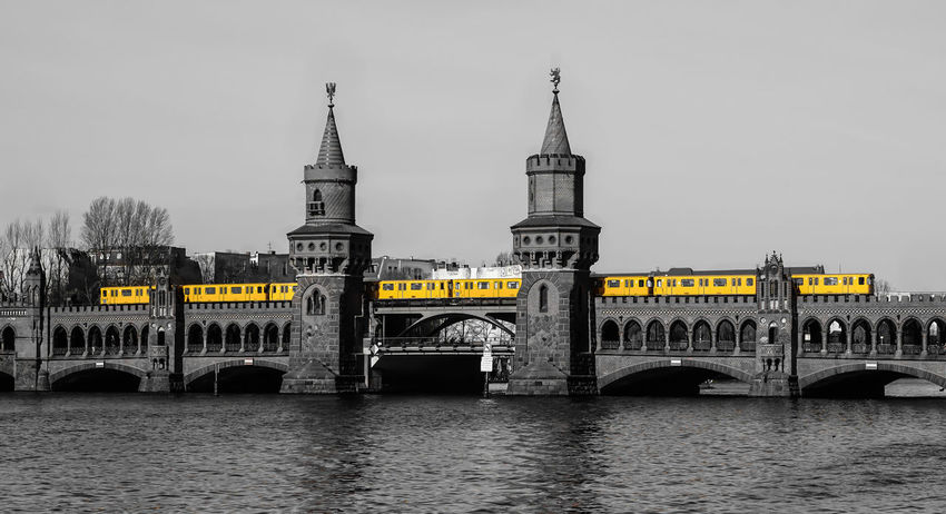 the Train on the bridge Architecture Architecture_collection Berlin Black And White Bridge Bridge - Man Made Structure Brücke Built Structure Clear Sky Famous Place Gelb Global Photographer Works Exhibition International Landmark Keycolor Mode Of Transport Oberbaumbrücke Tourism Transportation Travel Travel Destinations U-Bahn Ubahn Yellow Discover Berlin Krull&Krull Images Colorkey