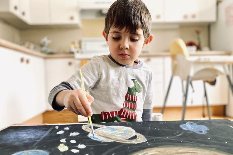 Boy making crafts at home