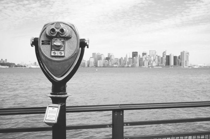 Coin-operated Binoculars City Binoculars Architecture Sea Building Exterior Water Close-up Sky Day Cityscape Outdoors Skyscraper No People NYC NYC Photography Liberty Island Manhattan Hudson River #urbanana: The Urban Playground