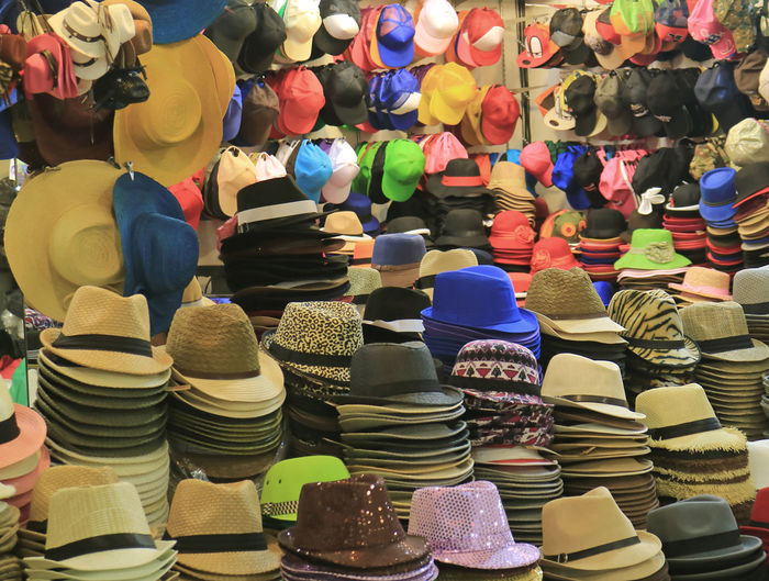 Multi colored hats for sale at market stall