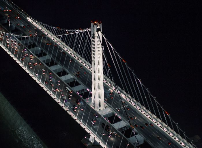 High angle view of illuminated suspension bridge at night