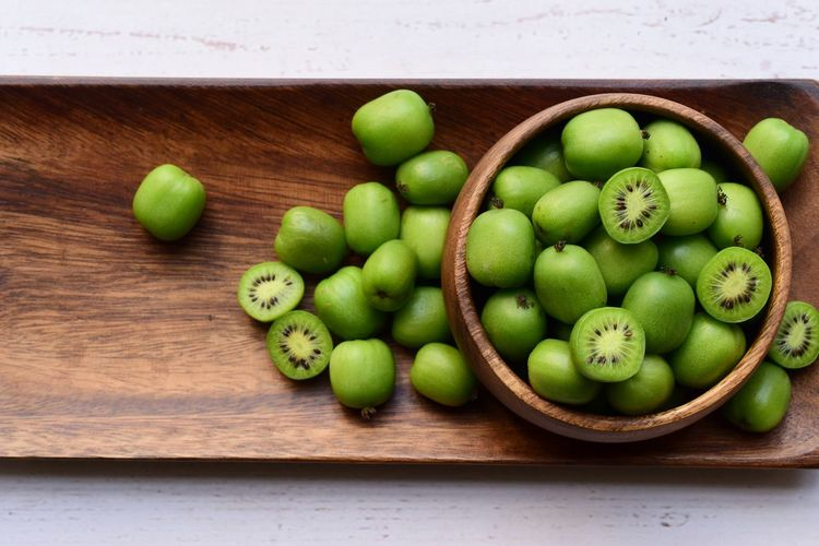 High angle view of green fruits on table