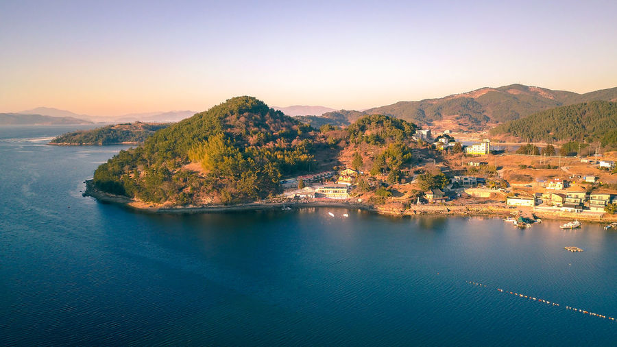Aerial view of blue sea and mountain, South Korea. Beautiful Beautiful Nature EyeEm Best Shots EyeEm Nature Lover EyeEmNewHere South Korea View Aerial View Bay Beauty In Nature Day Island Mountain Nature Outdoors Scenics Sea Summer Sunset Top View Village Water