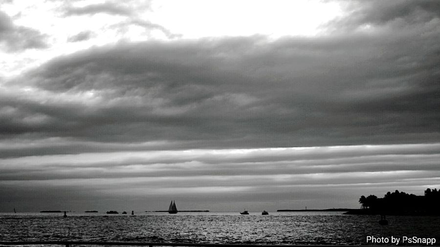 Sea Cloud - Sky Beauty In Nature Nature Water Outdoors Travel Destinations Sky Scenics Horizon Over Water Storm Cloud Tranquil Scene Tranquility Beach Vacations Thunderstorm Day No People Key West Black & White Seascape Photography For The Love Of Black And White Monochrome Blackandwhite Mallory Square Miles Away