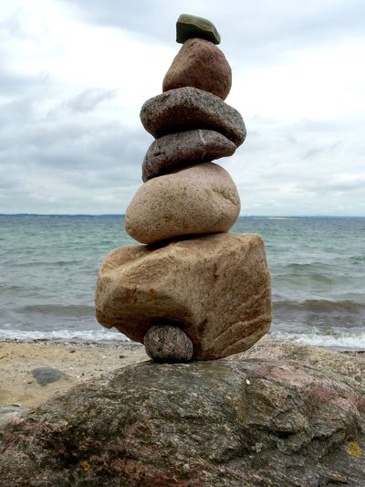 Stack Of Stones In Front Of Sea