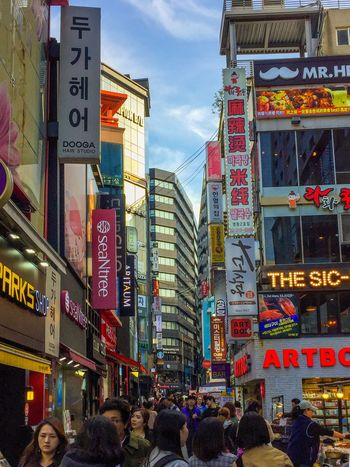 Shops at Myeongdong in Seoul, South Korea Retail  Shopping ASIA Tourism Travel Shops South Korea MyeongDong Building Exterior City Architecture Built Structure Text Communication Group Of People Crowd City Life Commercial Sign Street Sign Advertisement USY City Architecture City Life Building Sign