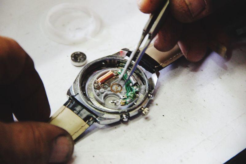 Hands Repairing Wristwatch