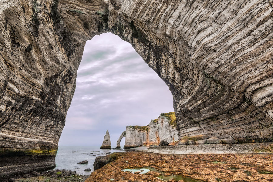 The last giants. Arch Attraction Beauty In Nature Cave Cliff Cloud - Sky Day From A Tourist Perspective Hiking Horizon Over Water Natural Arch Nature Nature No People Physical Geography Rock - Object Rock Formation Scenics Sea Sky Tranquility Travel Travel Destinations Water The Great Outdoors - 2017 EyeEm Awards Lost In The Landscape An Eye For Travel