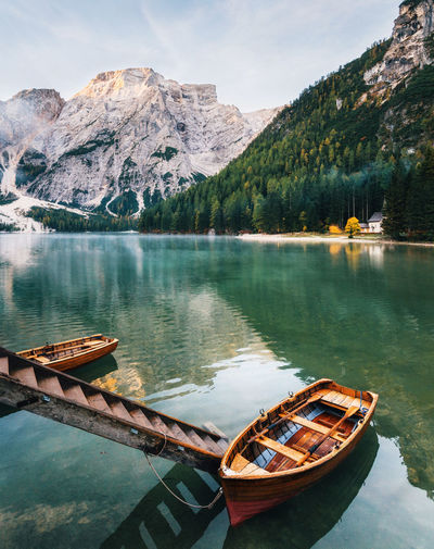 Boats and slip construction in Braies lake with crystal water in background of Seekofel mountain in Dolomites in morning, Italy Pragser Wildsee Dolomites Dolomites, Italy Braies Dolomiti Idyllic Italy Lake Mode Of Transportation Mountain Mountain Range Nature Nautical Vessel No People Outdoors Pragserwildsee Reflection Rowboat Tranquil Scene Water