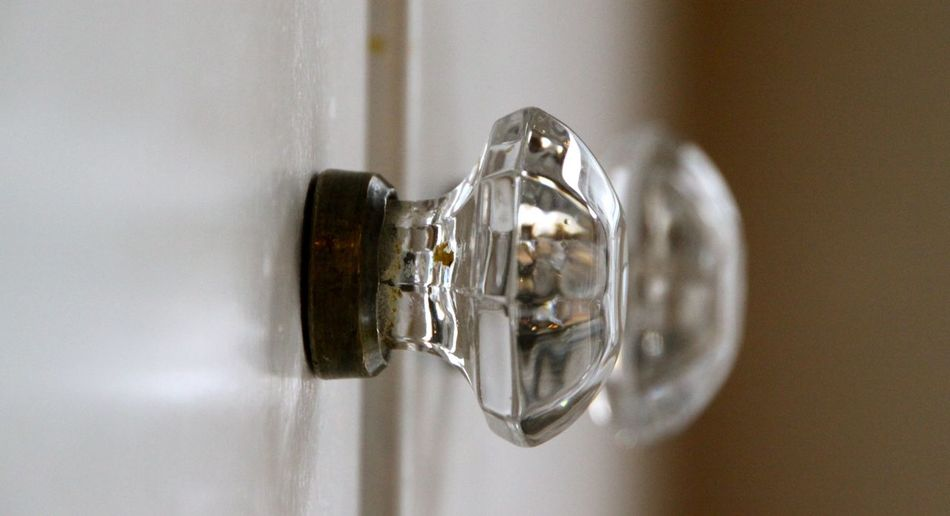 Close-up of glass hanging on wall