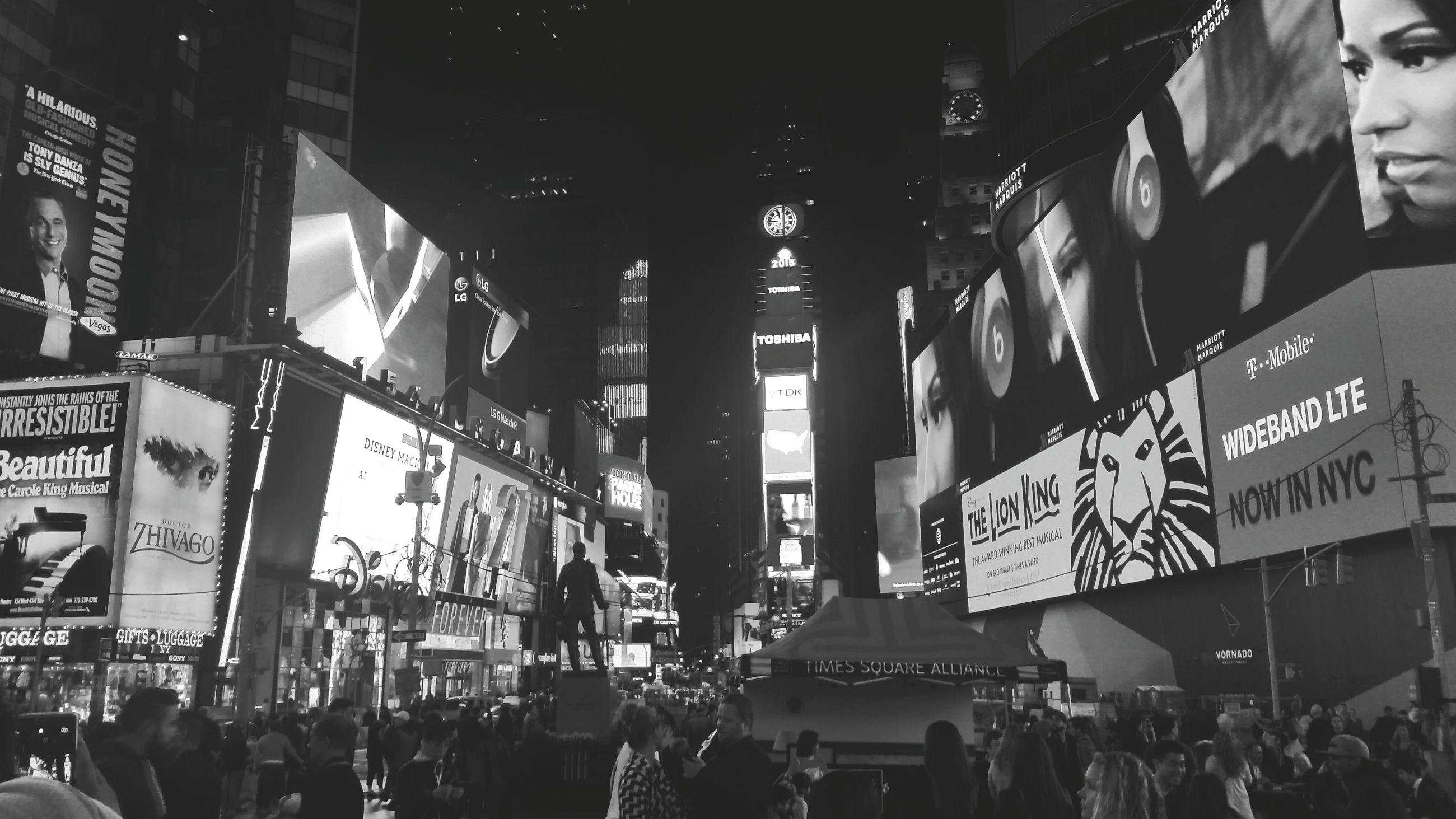 large group of people, text, men, person, architecture, crowd, built structure, western script, lifestyles, non-western script, communication, city, city life, building exterior, market, leisure activity, advertisement, shopping, walking