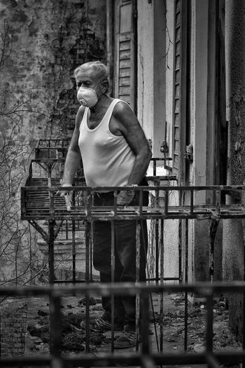 Full length of man standing in balcony