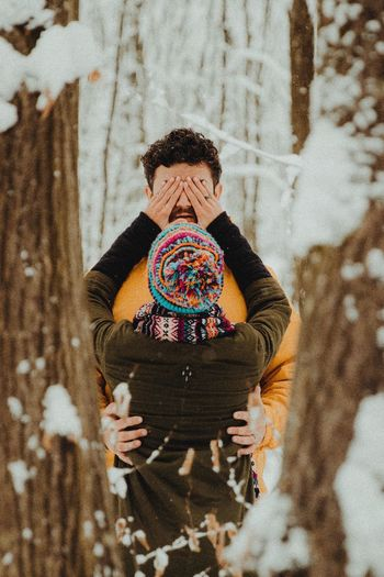 Wintertime Couple - Relationship Couple Real People One Person Lifestyles Leisure Activity Clothing Women Multi Colored Warm Clothing High Angle View Textile Day Winter Scarf