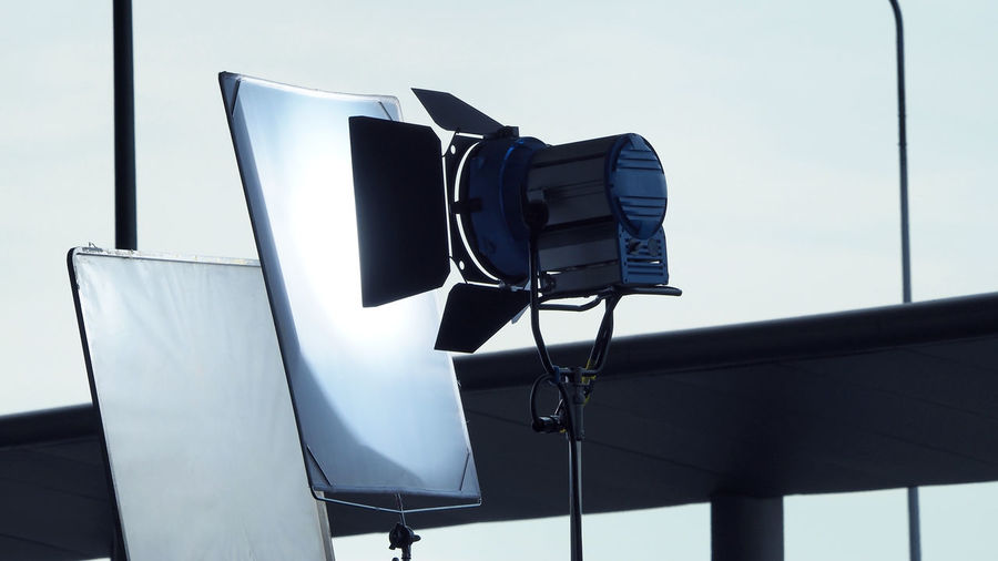 Close-up of photographic equipment against white backdrop