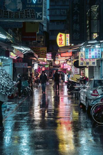 Night out in Taipei 2017 Night Lights Nightphotography Architecture Building Exterior Built Structure City City Life City Street Group Of People Illuminated Monsoon Night Outdoors Rain Rainy Season Real People Road Street Transportation Umbrella Walking Wet