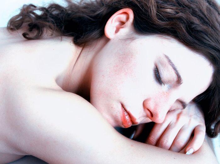 Close-Up Of Shirtless Woman Sleeping