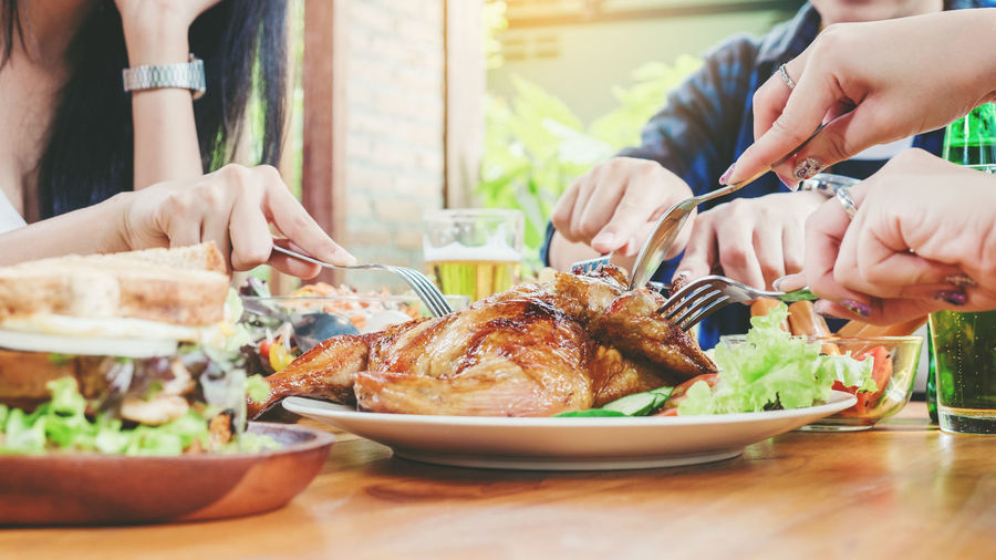 NewYear Thanksgiving Adult Chicken Meat Food Food And Drink Freshness Hand Holding Human Body Part Human Hand Indoors  Lifestyles Meat Men People Plate Ready-to-eat Real People Roast Turkey Table Togetherness Two People White Meat Women