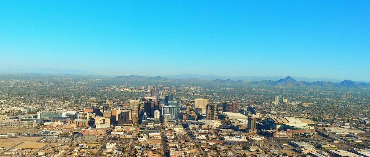 Hello Phoenix. Fromanairplanewindow Downtown Arizona Architecture Skyscraper Outdoors Travel Destinations City Built Structure Aerial View Sky Day Urban Skyline Desert