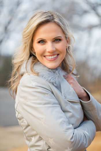 Portrait of a beautiful blond caucasian woman outside in winter wearing a winter coat Adult Beautiful Winter Winter Coat Woman Beautiful Woman Blond Hair Caucasian Close-up Cold Day Female Focus On Foreground Happiness Lifestyles Looking At Camera Middle Aged Outdoors Outside Portrait Real People Seasons Smiling Standing Waist Up