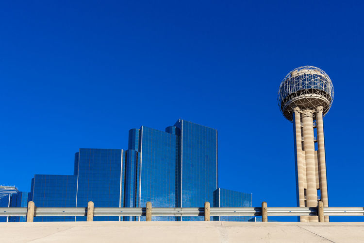Modern urban architecture against a vivid blue sky Construction Dallas Dallas Tx Perspectives on Nature Architecture Blue Building Exterior Built Structure City Clear Sky Communication Concrete Day Design Glass Windows Globe Modern Building No People Outdoors Perfectly Clear Sky Sky Travel Travel Destinations Vivid Blue