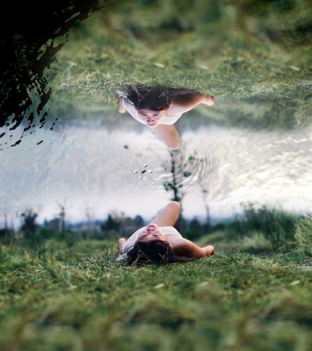 Multiple Exposure Of Young Woman Lying On Grass