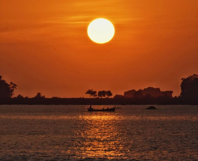 going to sail Sunset Sunlight Orange Color Yellow Red Boat Sailboat Sailing My Best Photo Water Astronomy Sunset Sea Silhouette Sun Illuminated Beauty Orange Color Refraction Calm Countryside Shining Sunbeam