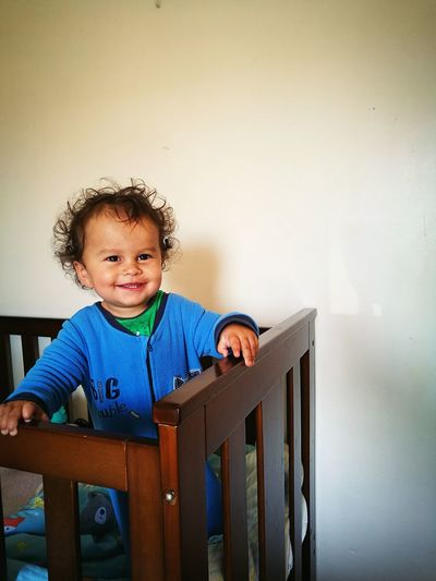 Happy Baby Boy In Crib At Home