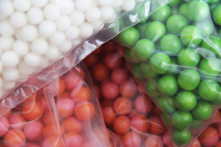 Close-Up Of Colorful Balls In Plastic Bags For Sale At Market