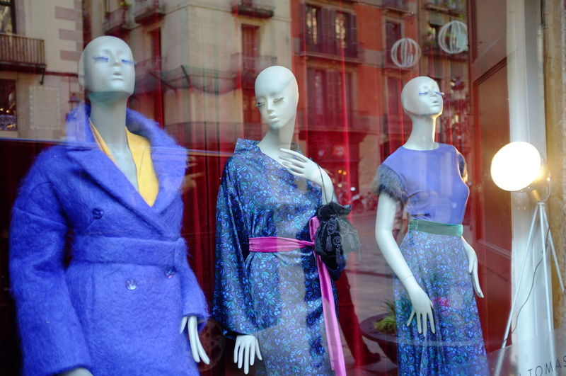 Blue Creativity Human Representation Mannequin Real People Woman's Fashion Reflection Woman's Clothing Blue Dress Reflected Buildings Glass Window