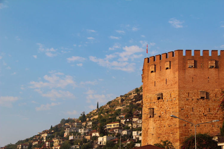 Building Exterior Architecture Built Structure Building Sky City Residential District Nature Cloud - Sky History The Past No People Fort Low Angle View Day Outdoors Travel Destinations Old Blue Fortified Wall Apartment Sea Travel Alanya Turkey