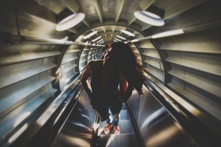 Rear view of woman walking in subway
