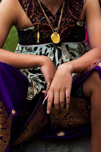 Tenganan youth wear traditional full clothes to attend traditional ceremonies.