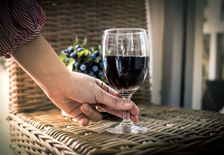 Red Wine Wine In A Glass Glass Food And Drink Wine Refreshment Drink Alcohol On Bar Bokeh Bokeh Lights Bokeh Background Bottle Poured In The Glass Hand Handle Two Glasses Mirror Friend Lover Restaurant Valentine Day - Holiday Wedding Day Happy Holidays! Night Lights